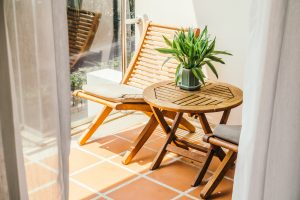 Empty chair and table around outdoor deck - Vintage Light Filter